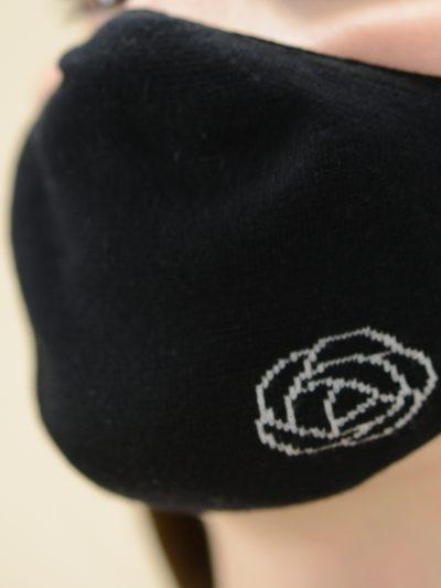 black mask logo flower